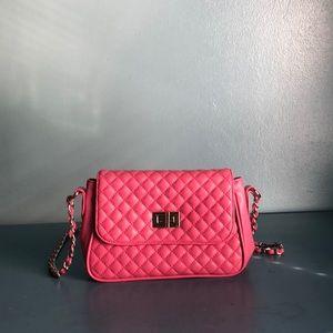 Pink quilted crossbody handbag